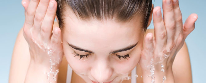 Fresh and lovely woman washing her face